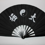 Black fan with design